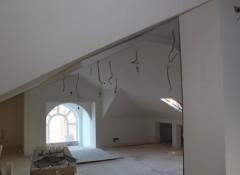 Преимущества и монтаж мансардных потолков из гипсокартона