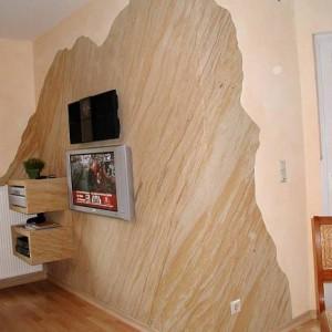 Использование в интерьере гостиной гибкого камня