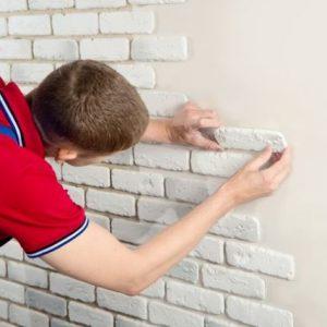 Укладка гипсовой плитки на стену