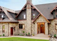 Использование искусственного камня для отделки фасада дома